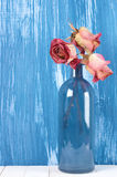 Dried roses in bottle Stock Photo