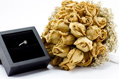 Dried roses bouquet and engagement ring Royalty Free Stock Images