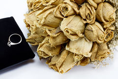 Dried roses bouquet and engagement ring Stock Images