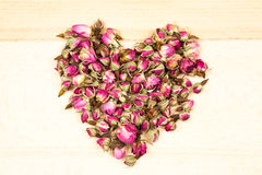 Dried roses and buds - heart shape Royalty Free Stock Images