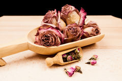 Dried roses and buds with wooden objects Royalty Free Stock Photo
