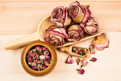 Dried roses and buds with wooden objects Royalty Free Stock Image