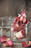 Dried roses in jar Stock Photo