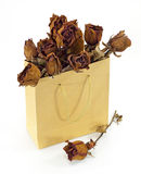 Dried roses in a paper bag Stock Images