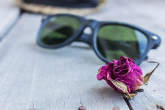 Dried roses and sunglasses Stock Photos