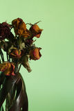 Dried roses in vase. In broken-hearted day Stock Photo