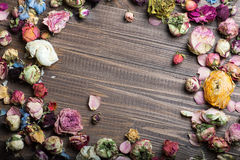 Dried roses on wood. Royalty Free Stock Photo