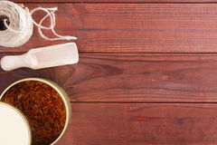 Dried saffron spice and material for packaging Royalty Free Stock Photo