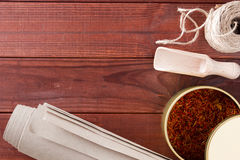 Dried saffron spice and material for packaging Stock Photo