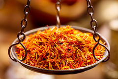 Dried saffron spice in vintage  bowl weights Stock Photos