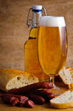 Dried salami, beer and bread Stock Photo