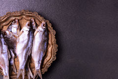 Dried in salt fish ram on scales on a copper tray, Stock Photos