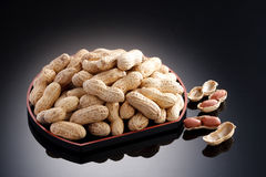 Dried salted peanuts on black plate in restaurant Royalty Free Stock Image