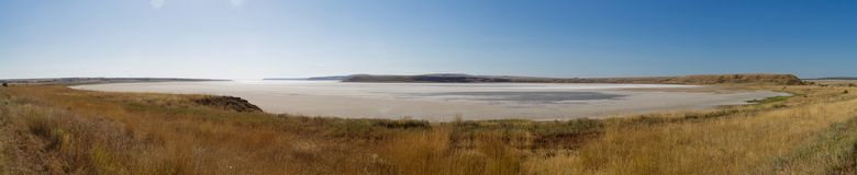 The dried salty lake. The water in the lake is pink. Panorama Royalty Free Stock Photography