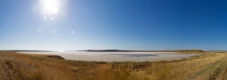 The dried salty lake. The water in the lake is pink. Panorama Stock Photo