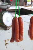 Dried sausage hanging with green rope royalty free stock photos