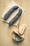 Dried sausage with peppercorn and ciabatta Royalty Free Stock Image