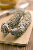 Dried sausage with peppercorn Royalty Free Stock Images