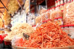 Dried Seafood Delicacies in Hong Kong. Focus on a pile of dried shrimp among other dehydrated seafood on sale at a store in Tai O, Hong Kong. Dried seafood Royalty Free Stock Images