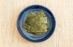 Dried seaweed on plate Stock Image