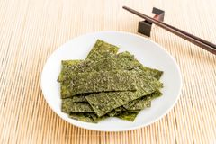 Dried seaweed on plate Royalty Free Stock Images