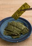 Dried seaweed on plate Stock Photography