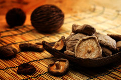 Dried Shiitake Mushroom on mat earth tone Royalty Free Stock Images