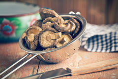 Dried shiitake mushrooms in colander royalty free stock photography