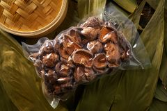 Dried Shiitake mushrooms in vacuum plastic blister. For Asian cuisine food Stock Images
