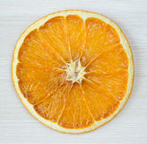 Dried slice of orange over white background Royalty Free Stock Images