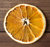 Dried slice of orange over wooden background Royalty Free Stock Photography