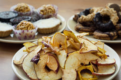 Dried sliced apples and tasty cookies royalty free stock photos