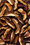 Dried forest mushrooms sliced on wooden background, top view Royalty Free Stock Photography