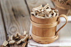 Dried and sliced marshmallow root. Marshmallow root Althaea officinalis in wooden cup. Copy space Stock Images