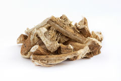 Dried and sliced marshmallow root. Pile of dried and sliced marshmallow root Althaea officinalis  on white background Stock Images