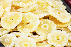 Dried sliced pineapple on the market place, detailed food scene Royalty Free Stock Photo