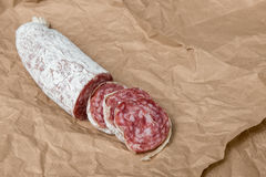 Dried sliced salami in paper Stock Photography