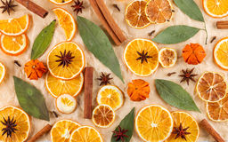 Dried slices of oranges, lemons, star anise, cinnamon sticks, Christmas background. Dried slices of oranges, lemons, star anise, cinnamon sticks  on beige Royalty Free Stock Photography
