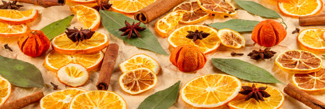 Dried slices of oranges, lemons, star anise, cinnamon sticks, Christmas background. Dried slices of oranges, lemons, star anise, cinnamon sticks  on beige Royalty Free Stock Photos