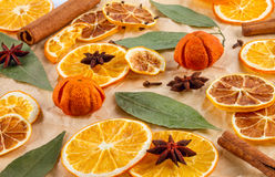 Dried slices of oranges, lemons, star anise, cinnamon sticks, Christmas background Stock Image