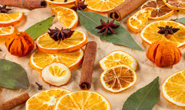 Dried slices of oranges, lemons, star anise, cinnamon sticks, Christmas background Stock Photography