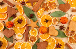 Dried slices of oranges, lemons, star anise, cinnamon sticks and gingerbreads, Christmas background Royalty Free Stock Photography