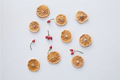 dried slices of oranges with red hawthorn berries on white background royalty free stock images
