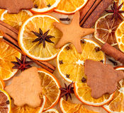 Dried slices of oranges, star anise, cinnamon sticks and gingerbreads on beige background, Christmas background. Dried slices of oranges, lemons, star anise Royalty Free Stock Photos
