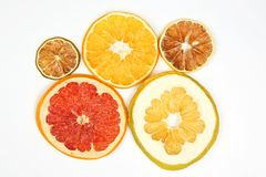 Dried slices of various citrus fruits closeup on white background