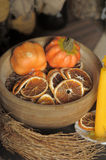 Dried small pumpkins and orange slices Royalty Free Stock Image