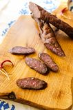 Dried and smoked romanian sausages stock images