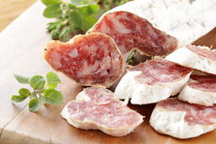 Dried smoked sausage sliced  Royalty Free Stock Images