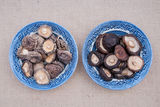 Dried and soaked shiitake in bowls Stock Photo