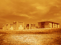 Dried soil and buildings Royalty Free Stock Photos